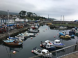 Carnlough Harbour with many boats.